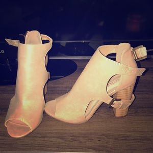 Cute open toe booties.  Never worn.